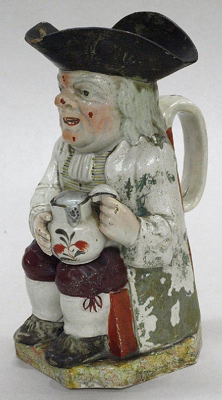 A Toby jug circa, 1780 (possibly by Enoch Wood):.