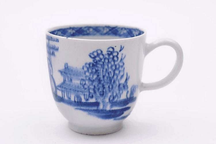 A Bow blue and white coffee cup painted with the