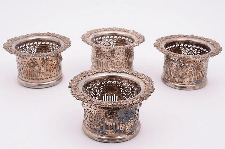 A set of four 19th Century plated coasters, the