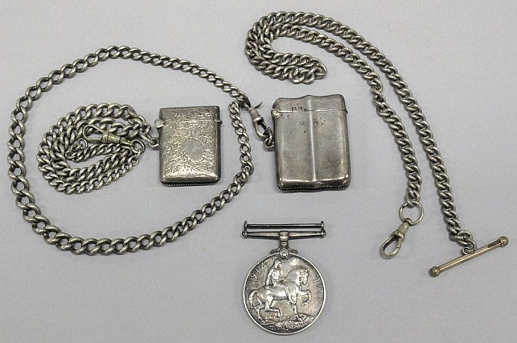 An Edwardian silver vesta case:, engraved with