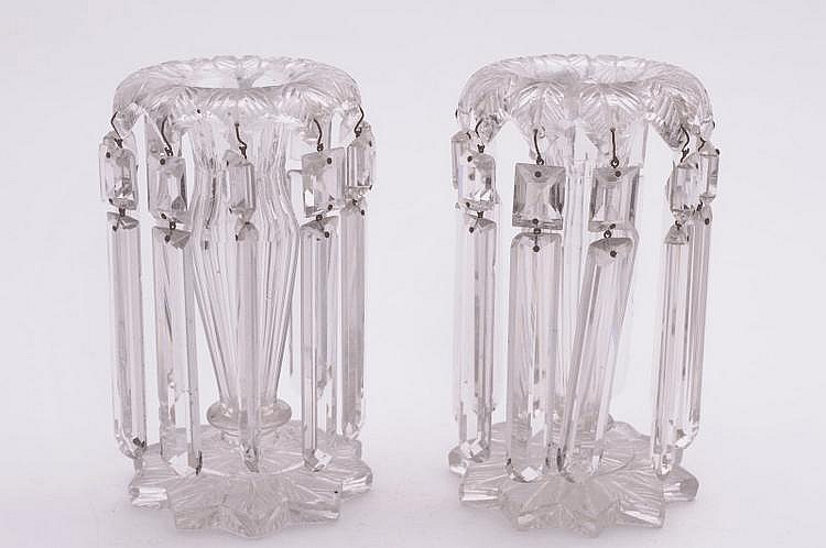 A pair of clear glass table lustres the foliate