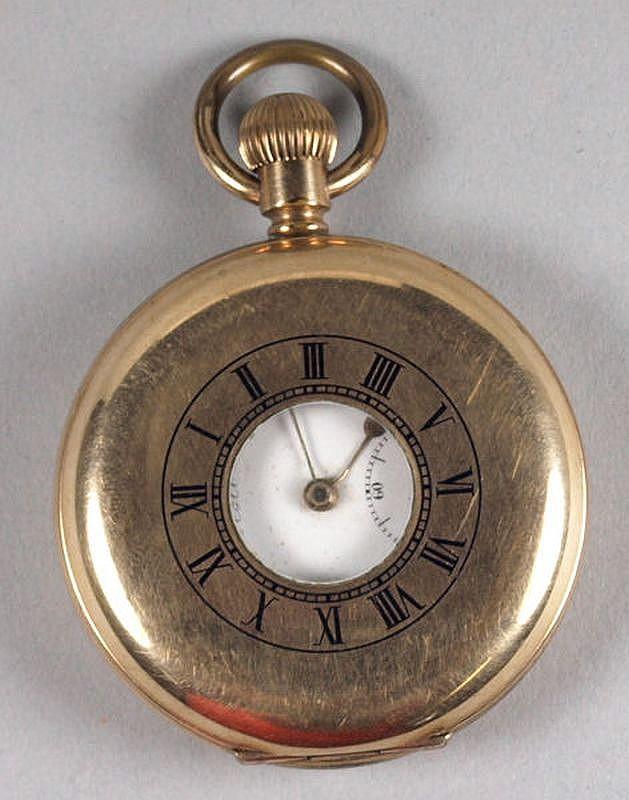 A gold plated half hunter pocket watch.