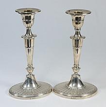 A pair of Edward VII silver candlesticks, maker