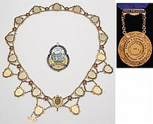 An ornate silver and enamel regalia chain and