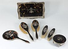 A George V silver and tortoiseshell inlaid