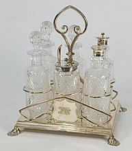 A Victorian plated six division condiment stand: