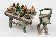 A Chinese pottery votive chair, table and food:
