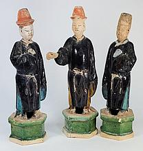 Three Chinese pottery tomb attendants: of standing