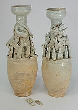 A pair of Qingbai funerary grain urns: of slender