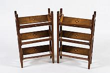 A pair of oak Arts and Crafts inlaid three tier