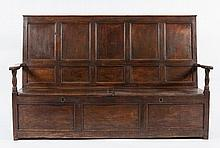 An 18th Century oak box settle:, with a