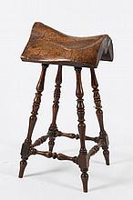 A rare Victorian pine and fruitwood saddle