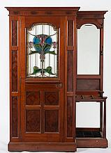 An Edwardian mahogany hall cupboard:, with a