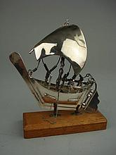 A Continental whitemetal model of a junk:, on a