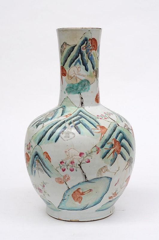 A Chinese porcelain bottle vase enamelled with