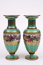 A pair of French enamelled green and opaline cased
