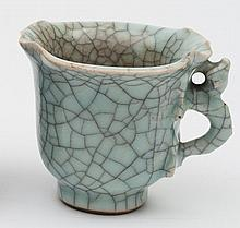 A Chinese celadon crackle glazed cup: in the form