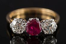 An 18ct gold, ruby and diamond three-stone ring: w