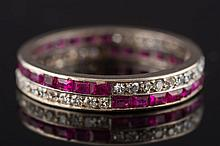 A 1930's ruby and diamond full eternity ring: with