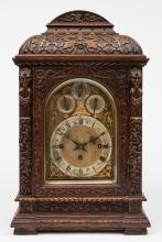 A Victorian carved oak chiming bracket clock: the
