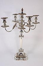 A plated four branch candelabra : with urn shaped