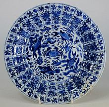 A Chinese blue and white dish: the centre painted