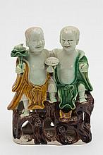 A Chinese biscuit porcelain figure group of Hehe