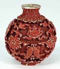 A Chinese porcelain 'faux cinnibar lacquer' snuff
