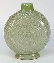 A Chinese celadon moon flask: finely moulded with