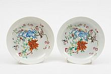 A pair of Chinese famille rose saucer dishes: each