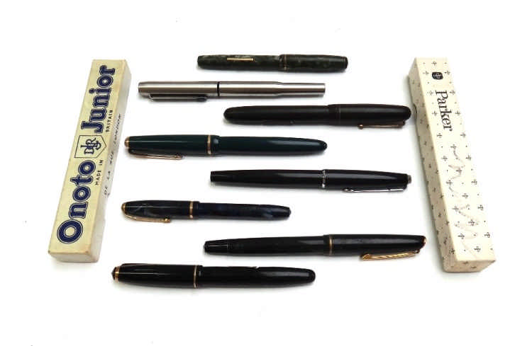 A collection of vintage fountain pens, comprising