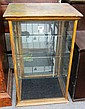 A mahogany glazed table top display cabinet with