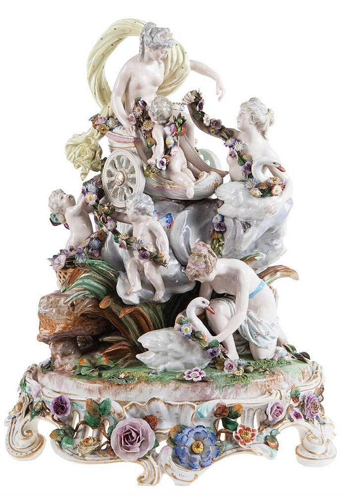 Impressive Meissen porcelain mythological group with Venus in chariot in the clouds above a rock, surrounded by nymphs and angels with flower garlands and swans. Mark underneath base.
