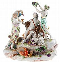 A Meissen porcelain mythological group with young Bacchus, couple of maenads, children of Bacchus, paraphernalia and dog. Crossed swords mark (on rock).