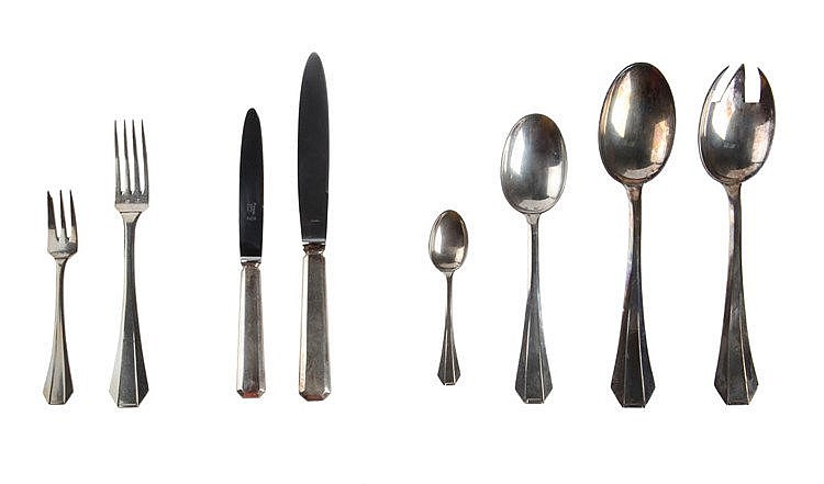 Twelve-piece flatware service by Delheid. Silver. Art Deco period. Comprising 12 dinner knives, 12 dinner forks, 12 dinner spoons, 12 small knives, 12 dessert forks, 11 coffee spoons and a two-piece salad server.