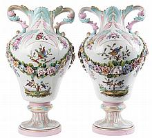 Pair of Meissen porcelain vases of footed globular shape painted with birds on flowering branches, sprigs and applied flower garlands. Leaf-shaped handles. Mark 'AR' for 'Augustus Rex'. Circa 1870. One vase restored to upper part.