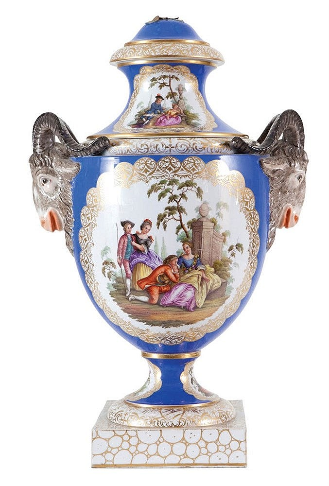 Egg-shaped vase with cover on foot. Dresden porcelain, circa 1870. Partly gilt and painted in colours with park scenes after Antoine Watteau in shaped medaillons on the ovoid shaped body and the cover. Ram head handles. Mark below foot 'AR'