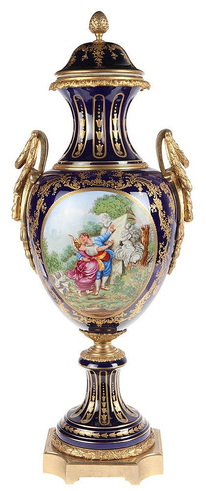 A Sèvres style gilt-metal mounted vase and cover, painted by C.Niccolier, with romantic couple in park, the reverse with vase on pedestal in park near the water. Marked. First half of the 20th century.