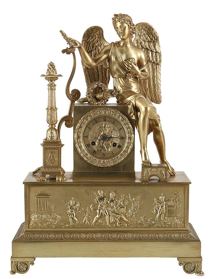Mantel clock. Gilt bronze. Dial with cherub surrounded by petals set in rectangular stand surmounted by a figure of Cupid with bow and arrow, the frieze chased with Venus, Cupid and angels near a temple in landscape. Charles X period.
