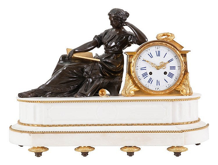 Mantel clock. Black patinated and fire-gilt bronze, white marble. Enamel dial flanked by a reclining figure of Sappho. On turned feet. Louis XVI style. Napoleon III period.