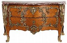 Chest of drawers. Rosewood veneer on an oak frame. Vaulted front with two drawers. Slanting corners. Gilt bronze mounts of rocailles, cartouches, shells and foliage on the drawers, the sides and the legs and 'des chutes' on the corners. Louis XV