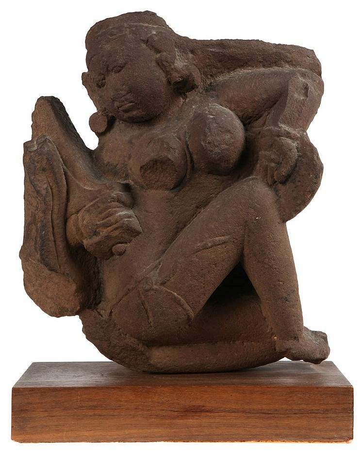 Stone bas-relief with the goddess Ambika, born out of the rays of light of the Hindu trinity (Brahman, Vishnu, Shiva). India, probably 13th-16th century. Hindu temple fragment.