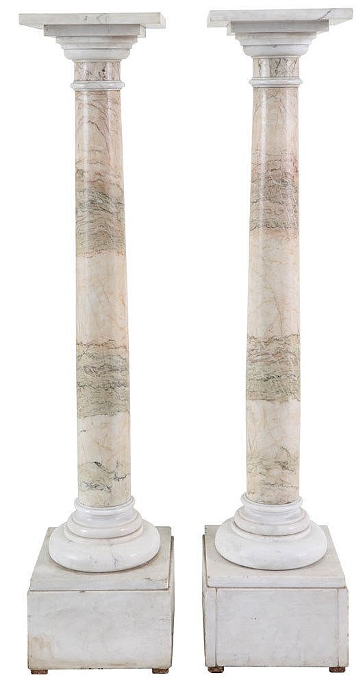 Pair of white-red veined marble pedestals.