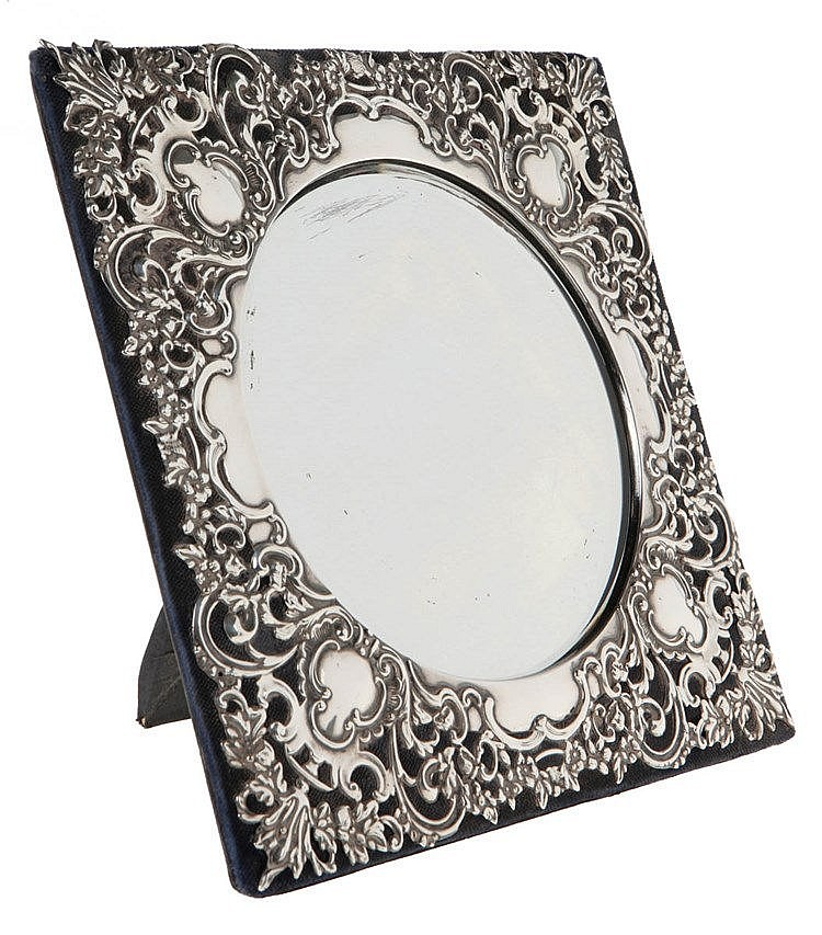 Dressing table mirror. Silver. Finely chased with rocaille, cartouche, flowers and foliage. Birmingham, 1904, silversmith Saunders & Hollings-Shepherd.