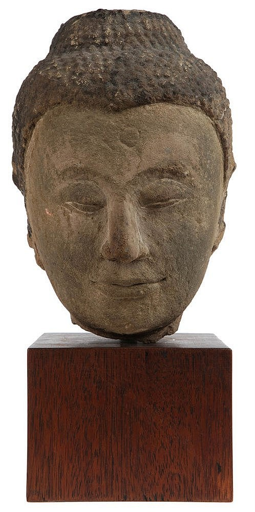 Head of Buddha Sakyamuni. Stone. Siam, 18th-19th century.