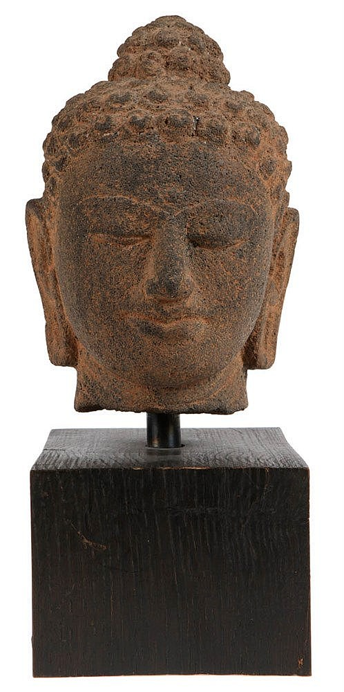 Head of Buddha Sakyamuni. Stone. 19th century Javanese style.