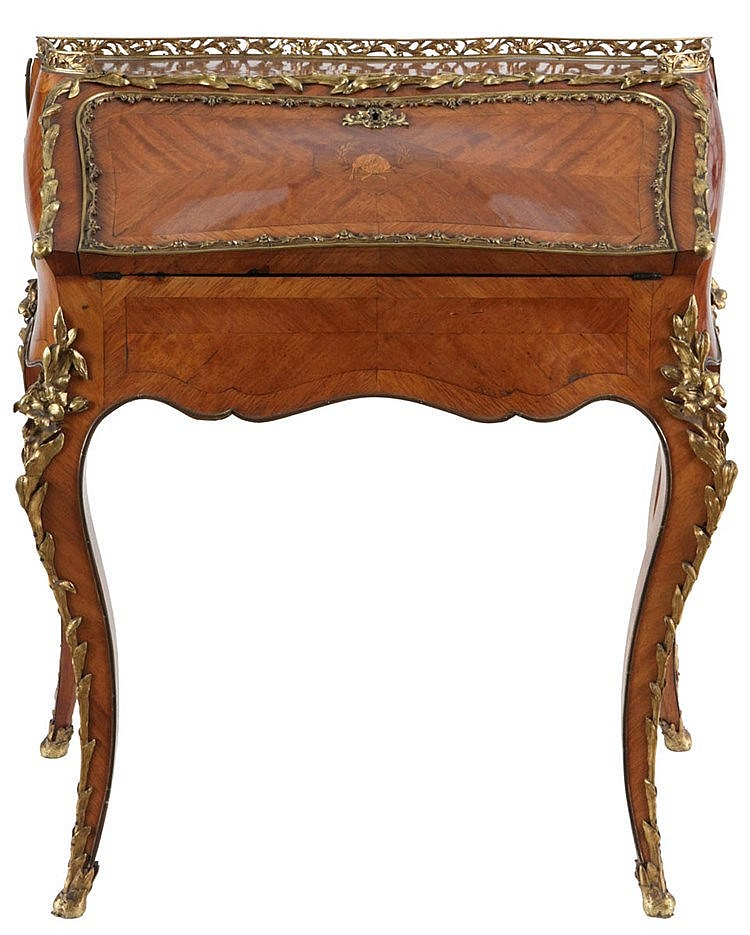 Ladies' writing desk. Rosewood veneer. Four cabriole legs. Nicely gilt bronze mounts of a plant garland at the rim of the dropleaf and blossoming branch on the legs. Hexagonal medallion with bagpipe and leaf garland on the top. Nicely gilt rim.