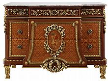 Breakfront chest of drawers. Mahogany inlaid with marquetry of various types of precious wood. Two drawers. Gilt wood mounts. Red-brown veined marble top. Louis XVI style. 20th century work.