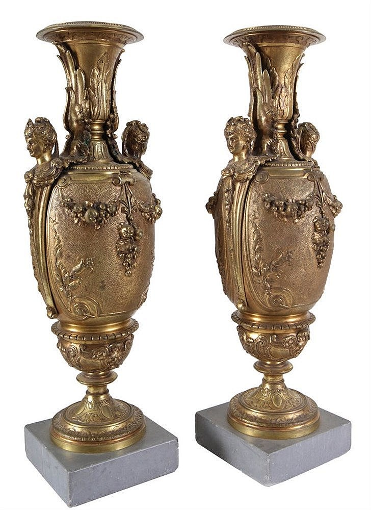 Pair of baluster vases. Firegilt bronze. Female herm shaped handles. Applied with fruit garlands. Louis XVI style. Napoleon III period. On grey marble stand of later date.