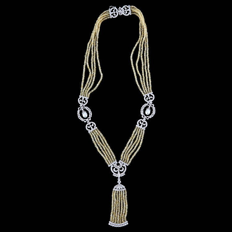 Neogothic style necklace. White gold, 18 ct, 30 g. Set with five rows of yellow saphire beads and 449 brillant-cut diamonds, 5.02 ct, quality G SI1.